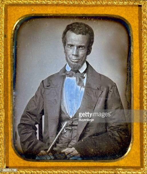 Edward J Roye threequarter length portrait standing with hand raised