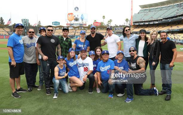 Edward James Olmos and his family pose with the cast of Mayans MC at The Los Angeles Dodgers Vs Arizona Diamondbacks Game at Dodger Stadium on...