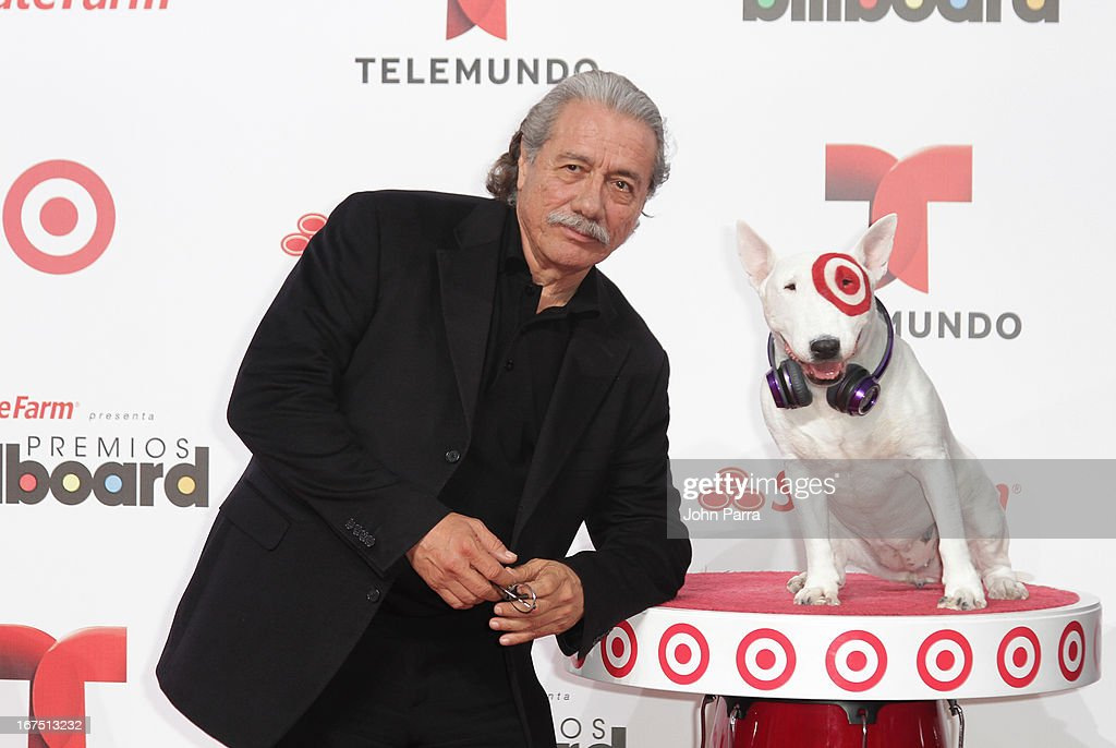 Edward James Olmos celebrates with Bullseye, Target's Beloved Bull Terrier Mascot, at the 2013 Billboard Latin Music Awards at BankUnited Center on April 25, 2013 in Miami, Florida.