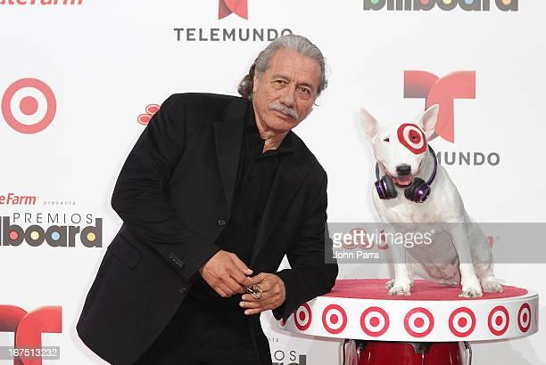 Edward James Olmos celebrates with Bullseye Target's Beloved Bull Terrier Mascot at the 2013 Billboard Latin Music Awards at BankUnited Center on...