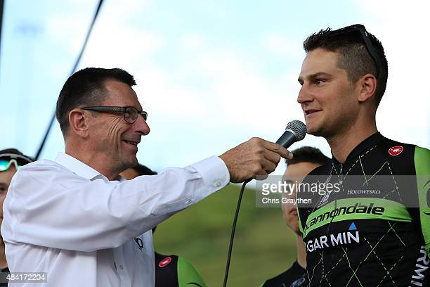 Edward King of the United States riding for Cannondale-Garmin talks with Paul Sherwen during team presentations ahead of the 2015 USA Pro Challenge...