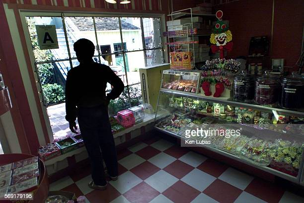 Edward Ko looks out of the window of his candy shop in Ports of Call Village and talks about how tourism in the area has dropped off in the 12 years...