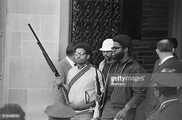 Edward L. Whitefield , chairman of the Afro-American Society at Cornell University, and Eric Evans , another leader of that group, lead other...