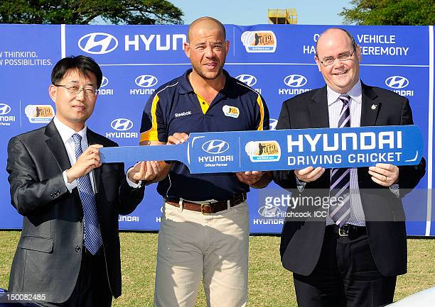 Edward Lee the CEO of the Hyundai Motor Company Australia Andrew Symonds ICC Under 19 Ambassador and Tony Hallam CFO of ICC CWC2015 pose during the...