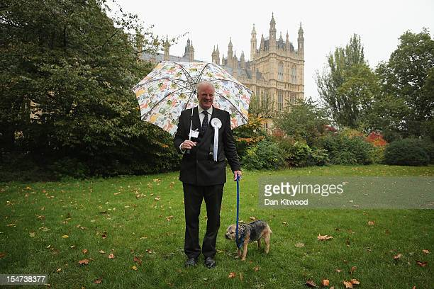 Edward Leigh Conservative MP for Gainsborough stands in front of The Houses of Parliament with his dog William a Border Terrier during the...