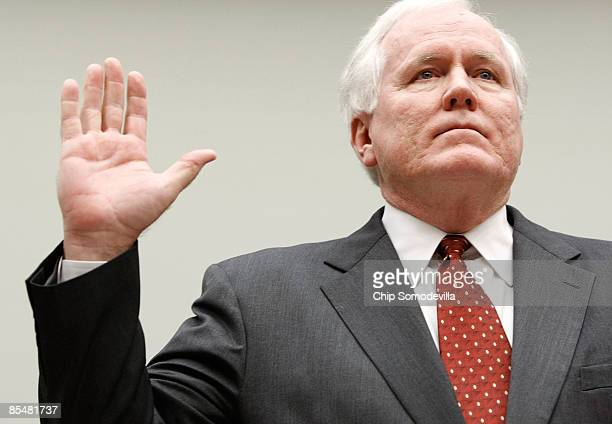Edward Liddy chairman and CEO of the American International Group raises his right hand as he is sworn in during a House Financial Services Committee...