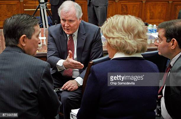 Edward Liddy introduces Rep. Dennis Kucinich and AIG Vice Chairman for Legal Affairs Anastasia Kelly during a break in testimony before the House...