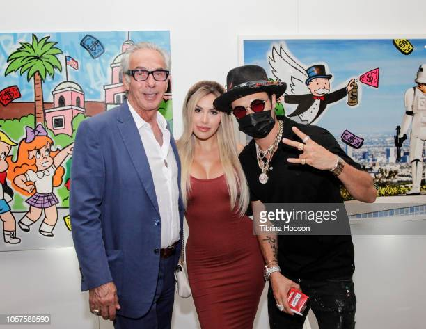 Edward Mady Alexa Dellanos and Alec Monopoly attend the Alec Monopoly Beverly Hills Hotel Capsule Collection unveiling on November 4 2018 in Beverly...
