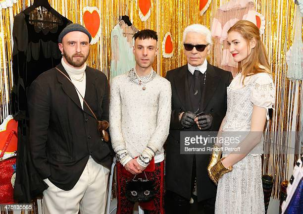 Edward Meadham and Benjamin Kirchhoff designers of Meadham Kirchhoff Karl Lagerfeld and a model attend LVMH Prize SemiFinalists Designers Cocktail...