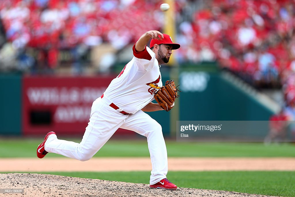 Edward Mujica #44 of the St. Louis Cardinals pitches in the ninth inning against the Pittsburgh Pirates during Game Two of the National League Division Series at Busch Stadium on October 4, 2013 in St Louis, Missouri.