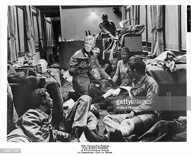 Edward Mulhare in room full of wounded men in a scene from the film 'Von Ryan's Express', 1965.