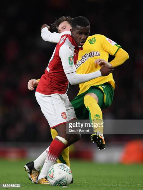 Edward Nketiah of Arsenal and James Husband of Norwich City clash during the Carabao Cup Fourth Round match between Arsenal and Norwich City at...