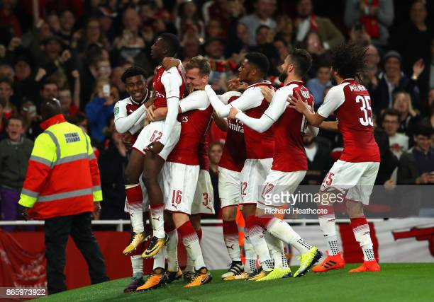 Edward Nketiah of Arsenal celebrates with team mates after scoring his sides second goal during the Carabao Cup Fourth Round match between Arsenal...