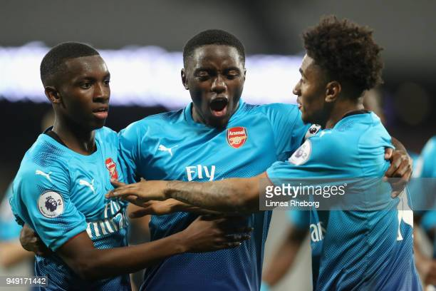 Edward Nketiah of Arsenal celebrates with teammates Josh Dasilva and Reiss Nelson after scoring his sides third goal during the Premier League 2...