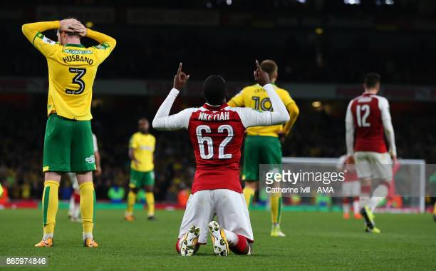 Edward Nketiah of Arsenal drops to his knees and prays after the Carabao Cup Fourth Round match between Arsenal and Norwich City at Emirates Stadium...