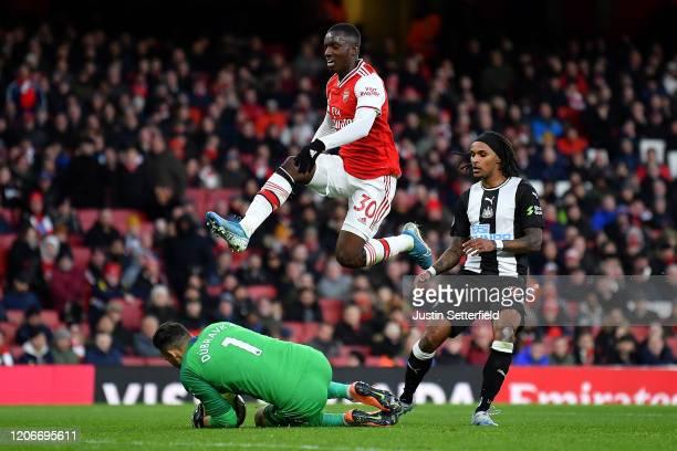 Edward Nketiah of Arsenal hurdleds Martin Dubravka of Newcastle United during the Premier League match between Arsenal FC and Newcastle United at...