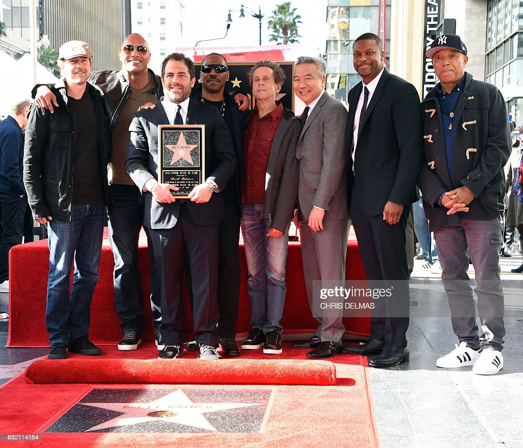 Edward Norton, Dwayne Johnson, Brett Ratner, Eddie Murphy, Brian Grazer, Kevin Tsujihara, Chris Rock and Russell Simmons attend Ratner's star on the Walk of Fame ceremony in Hollywood on January 19, 2017. / AFP / CHRIS