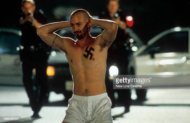 Edward Norton is surrounded by the police in a scene from the film 'American History X' 1998