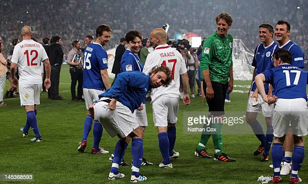 Edward Norton Mike Myers Gerard Butler Freddie Ljungberg and Edwin Van Der Sar attend The Soccer aid foorball match in aid of UNICEF at Old Trafford...