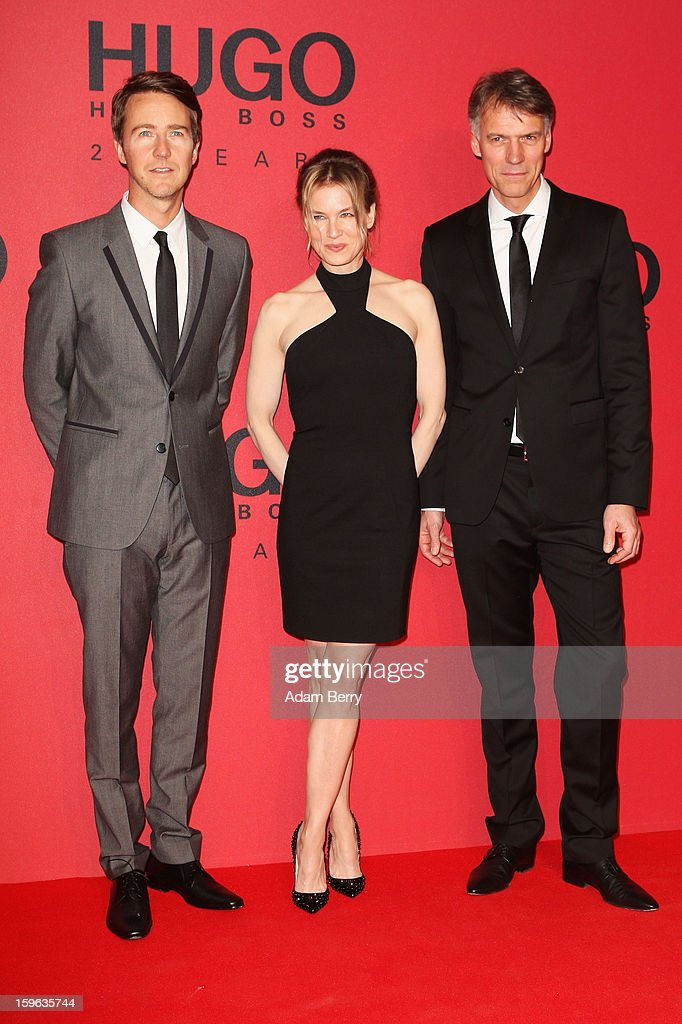 Edward Norton, Renee Zellweger and 'Hugo Boss CEO' Claus-Dietrich Lahrs attend Hugo By Hugo Boss Autumn/Winter 2013/14 fashion show during Mercedes-Benz Fashion Week Berlin at The Brandenburg Gate on January 17, 2013 in Berlin, Germany.