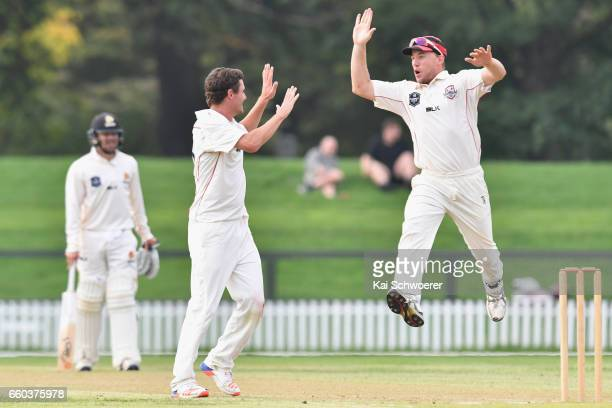 Edward Nuttall of Canterbury is congratulated by Logan van Beek of Canterbury after dismissing Luke Ronchi of Wellington during the Plunket Shield...