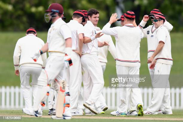 Edward Nuttall of Canterbury is congratulated by team mates after dismissing Daniel Flynn of Northern Districts during the Plunket Shield match...