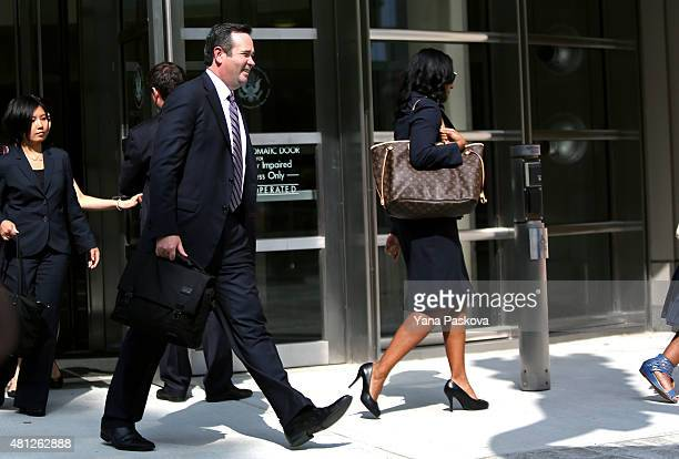 Edward O'Callaghan the lawyer of former Vice President Of FIFA Jeffrey Webb walks out of Brooklyn Federal Court with family members of Webb after...