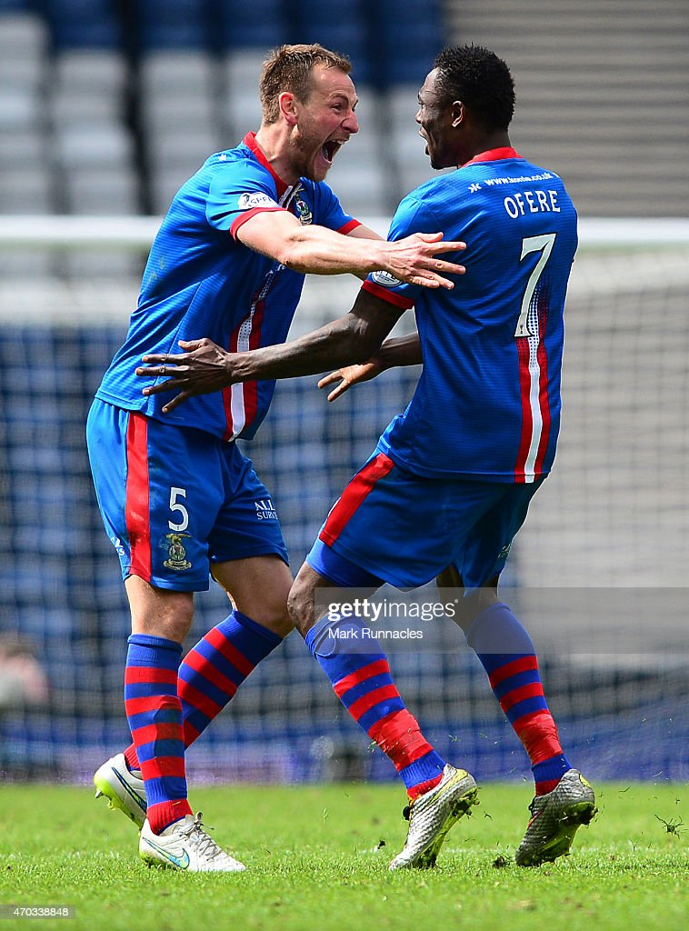 Edward Ofere of Inverness Caledonian Thistle celebrates scoring a goal with team mate Garry Warren in the first period of extra time during the William Hill Scottish Cup Semi Final match between Inverness Caledonian Thistle and Celtic at Hamden Park on April 19, 2015 in Glasgow Scotland.
