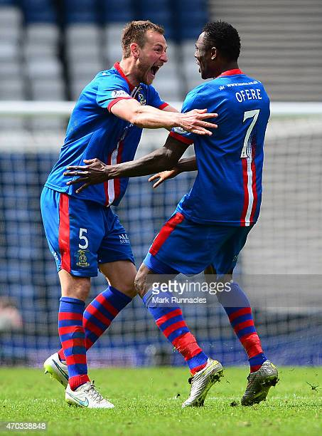 Edward Ofere of Inverness Caledonian Thistle celebrates scoring a goal with team mate Garry Warren in the first period of extra time during the...
