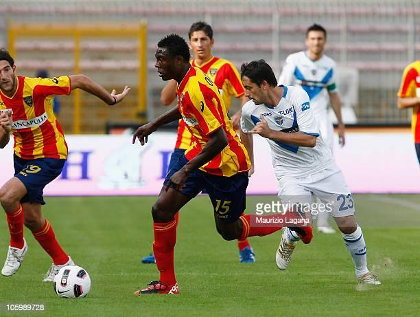 Edward Ofere of Lecce is chased by Simone Dallamano of Brescia Calcio during the Serie A match between Lecce and Brescia Calcio at Stadio Via del...