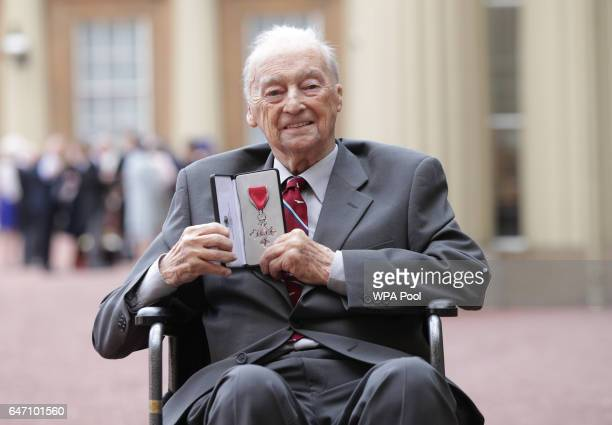 Edward Perry from The Guinea Pig Club at Buckingham Palace in London after receiving his Member of the Order of the British Empire from the Duke of...