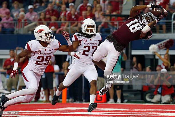 Edward Pope of the Texas A&M Aggies pulls in a pass for a touchdown against Jared Collins of the Arkansas Razorbacks and Alan Turner of the Arkansas...