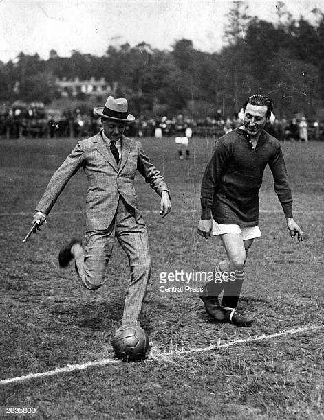 Edward Prince of Wales kicks off a charity football match between Tottenham Hotspur and Fulham after inspecting the Champion Cadet Battalion at...