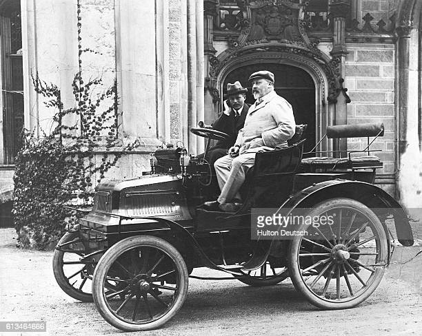 Edward Prince of Wales sits on the Daimler automobile of Mr Montagu while a guest at Highcliffe Castle the home of Mr and Mrs George Bentinck