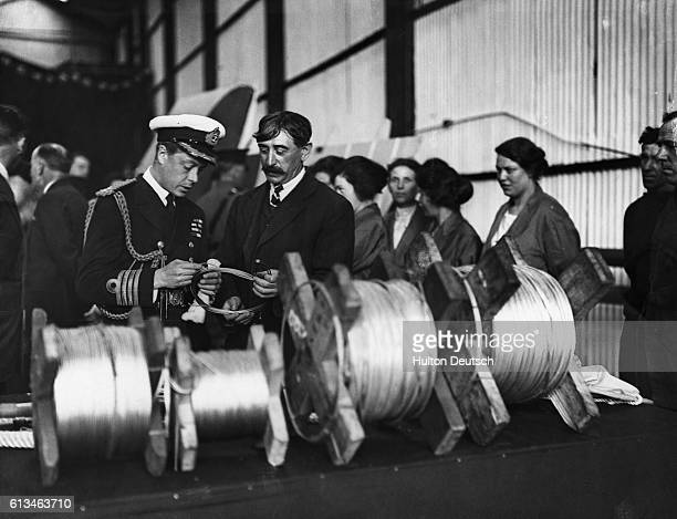 Edward Prince Of Wales talks to the foreman during a visit to the supermarine aviation works in Southampton