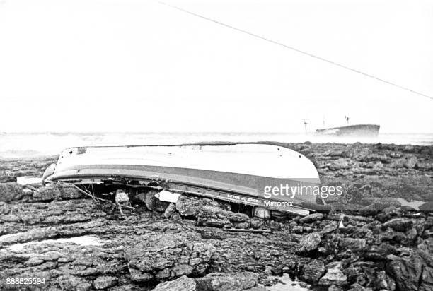 Edward Prince of Wales, the Mumbles lifeboat in which eight Mumbles men lost their lives, lies upturned where the sea beached her on Sker beach. In...