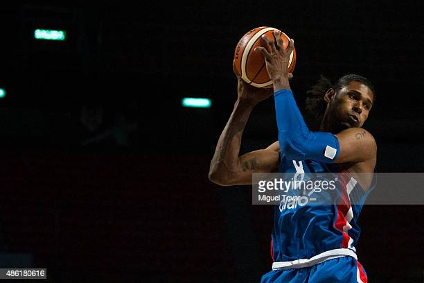 Edward Santana of Dominican Republica grabs a rebound during a match between Brazil and Dominican Republic as part of the 2015 FIBA Americas...