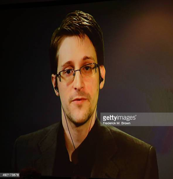 Edward Snowden is seen on a monitor as he speaks druing a live video feed during Politicon at the Los Angeles Convention Center on October 10 2015 in...