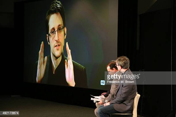 Edward Snowden on monitor speaks to panelist Andy Bichlbaum Mike Bonanno and actor David Neal during Politicon at the Los Angeles Convention Center...