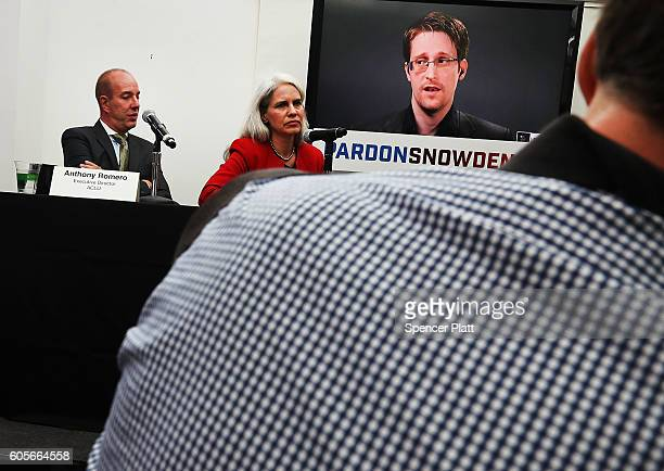 Edward Snowden speaks via video link at a news conference for the launch of a campaign calling for President Obama to pardon him on September 14 2016...
