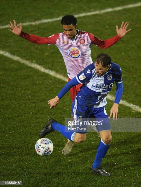 Edward Upson of Bristol Rovers looks to break past Terence Vancooten of Stevenage during the Leasingcom Trophy Third Round match between Bristol...