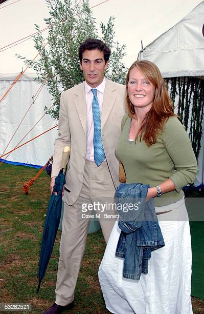 Edward Van Cutsem and his wife Lady Tamara Grosvenor attend the Cartier International Day at Guards Polo Club Windsor Great Park on July 24 2005 in...