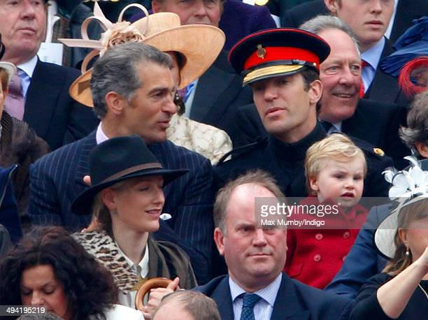 Edward van Cutsem and Nicholas van Cutsem watch Queen Elizabeth II presents new Standards to the Household Cavalry at Horse Guards Parade on May 28...
