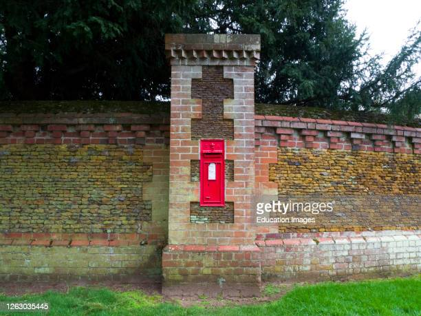 Edward VII post box, Post box No. PE35 351 in the wall on Sandringham Estate, Norfolk, UK .
