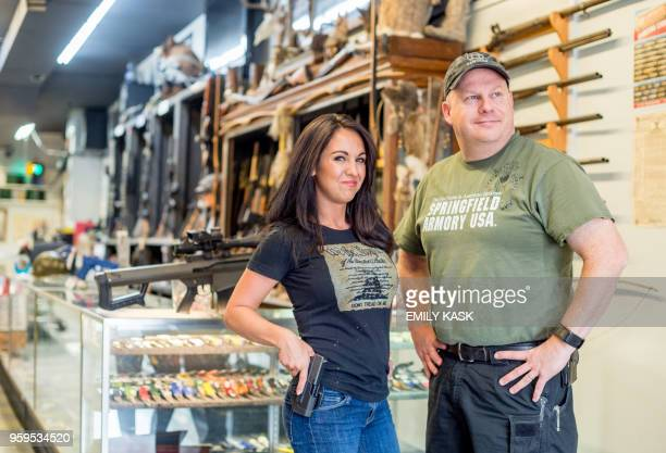 Edward Wilks owner of Tradesmen Gun Store and Pawnshop poses for a portrait with Lauren Boebert at his store in Rifle Colorado on April 24 2018...