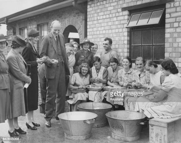 Edward Wood, 1st Earl of Halifax and Lady Halifax visit a communal kitchen in Hull, where they are inspecting air raid damage, England, World War II,...