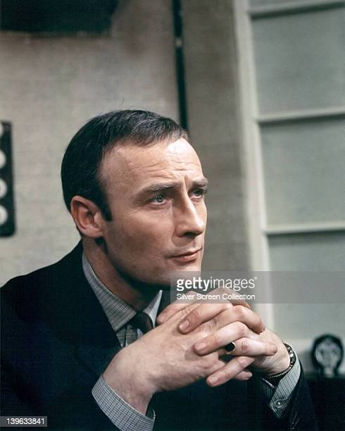 Edward Woodward , British actor, with his hands clasped together in front of him in a publicity portrait issued for the British television series,...