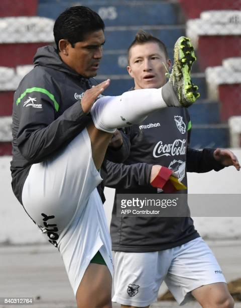 Edward Zenteno and Alejandro Chumacero take part in a training session at the Hernando Siles stadium in La Paz on August 28 ahead of Bolivia's...