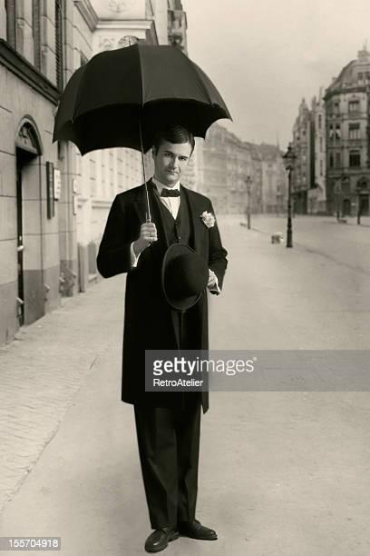 Edwardian style.Under umbrella