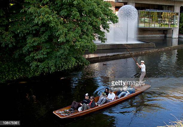 Edwardian-garbed punter with straw boater hat, guides tourists along the banks of the Avon River near Victoria Park Fountain on December 14, 2010 in...